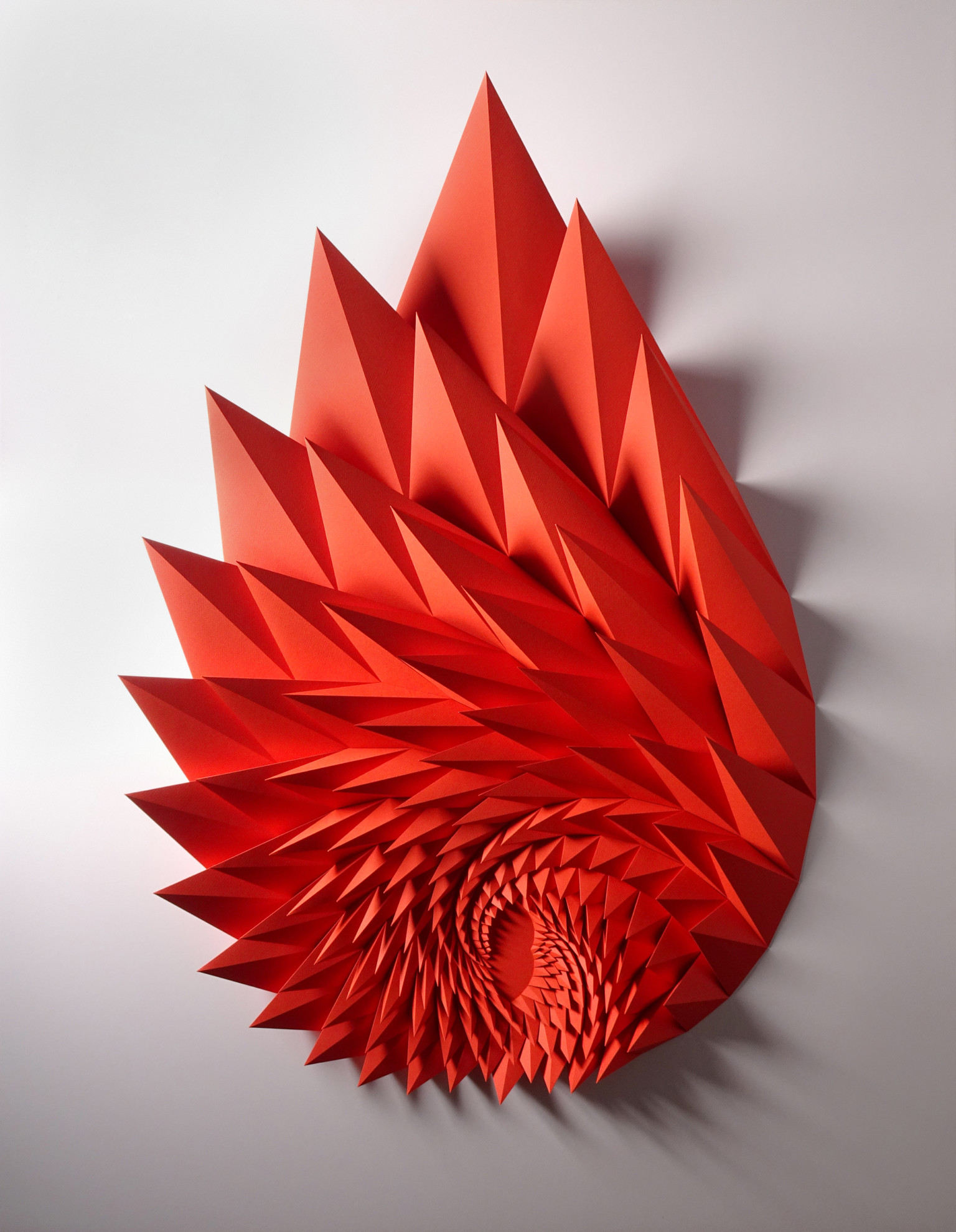 Folded paper sculpture by Matthew Shlian