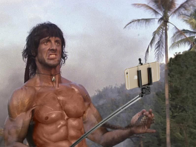 Still from Rambo movie that replaces his gun with a selfie stick