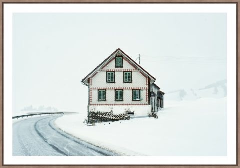 Photo of house in Switzerland in the snow